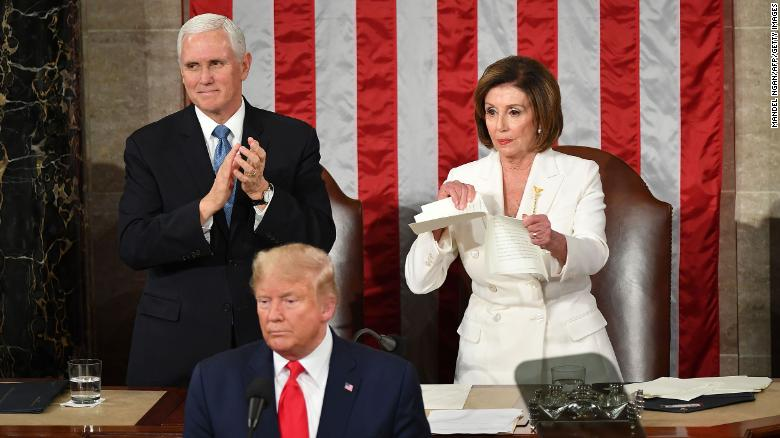 Vice President Mike Pence claps as Speaker of the US House of Representatives Nancy Pelosi rips a copy of President Trump's speech after he delivers the State of the Union address