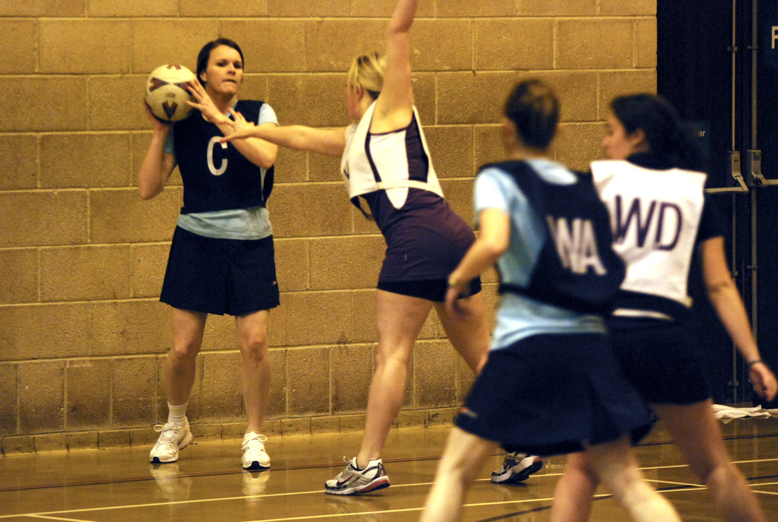 Female netball player in dark
