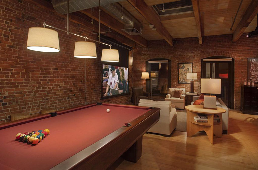 man-cave-loft-with-pool-table-and-brick-walls.jpeg
