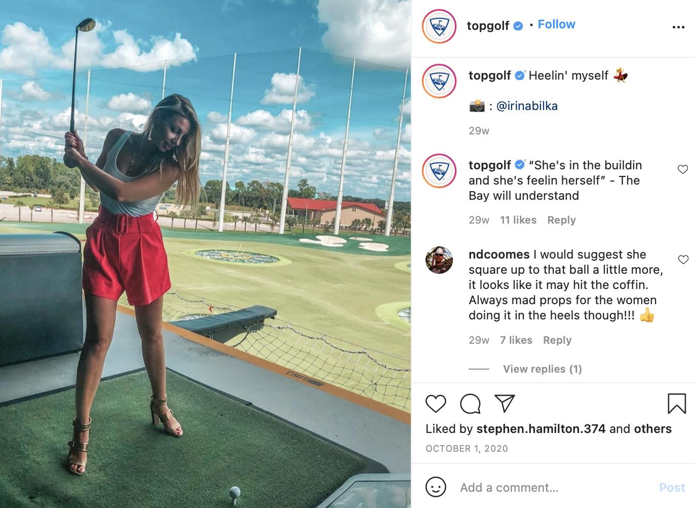girl swinging at top golf