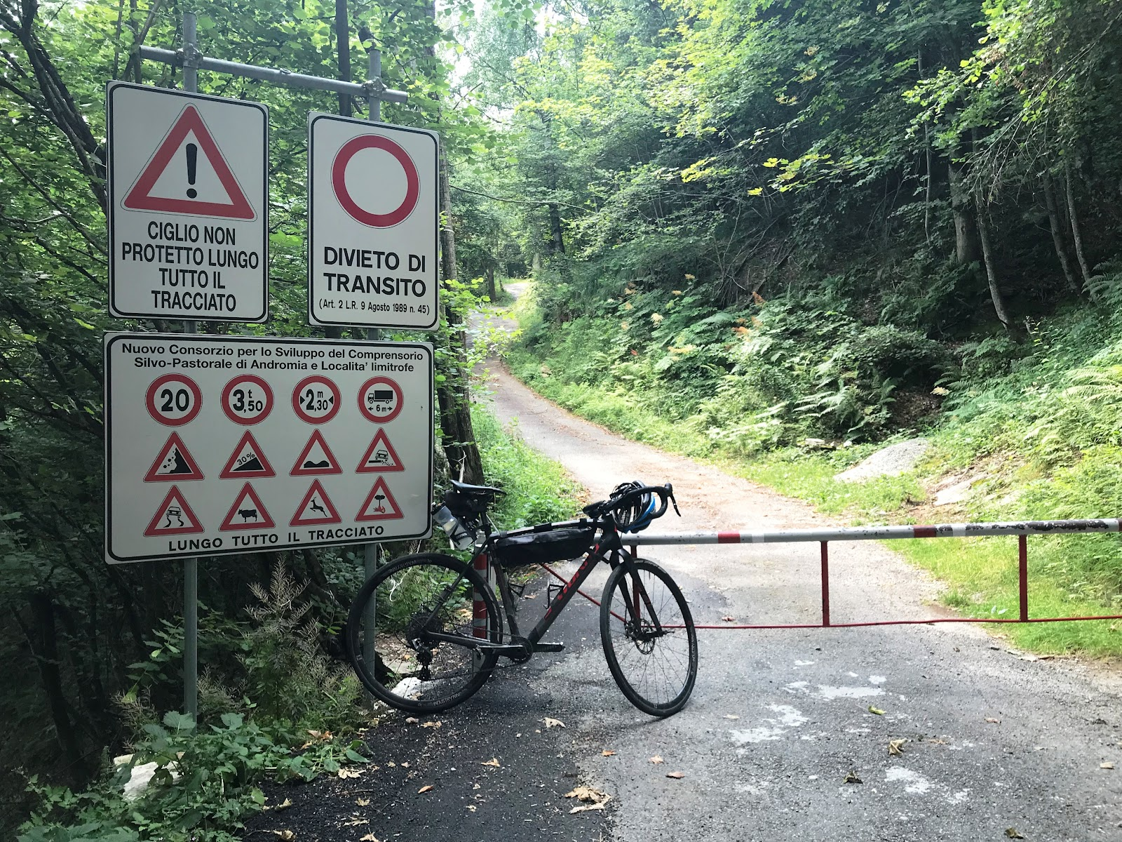 Cycling Alpe Fuori, Italy  one of the steepest bike climbs in Italy - bike and road sign.