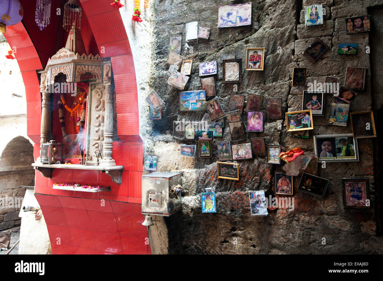 Hindu shrine for parents praying for children at the entrance to Stock ...
