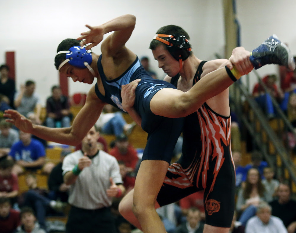 Brian Livermore of Biddeford takes down Hunter White of Dirigo during the 138-pound final Saturday at the Atlantic Invitational in Wells. Livermore won the match, 12-8, and was chosen as the meet's outstanding wrestler.