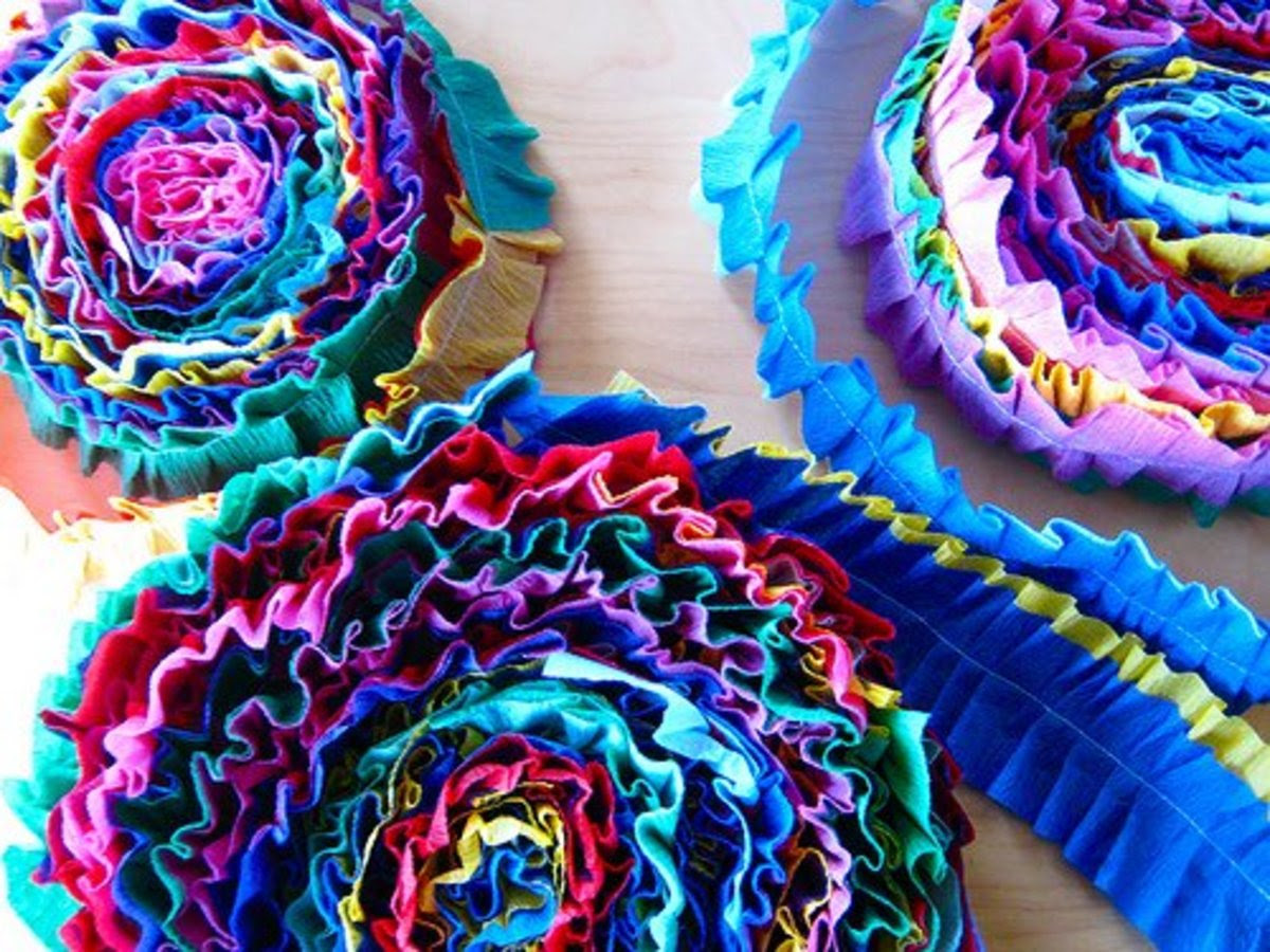 Sew two different colors of Crepe paper streamers together to make these wonderfully ruffly rainbow streamers. The best part? They are reusable! (Pop over to this link to learn more)