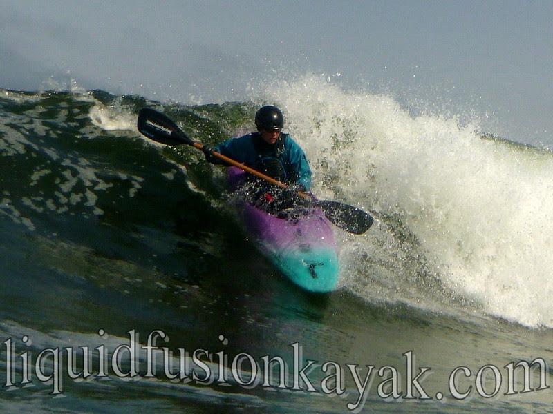 Kayak surfing on Mendocino Coast