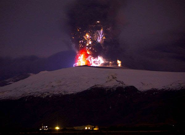 Lightning envelops a plume of ash that comes out of the Eyjafjallajokull volcano in Iceland, on April 19, 2010.