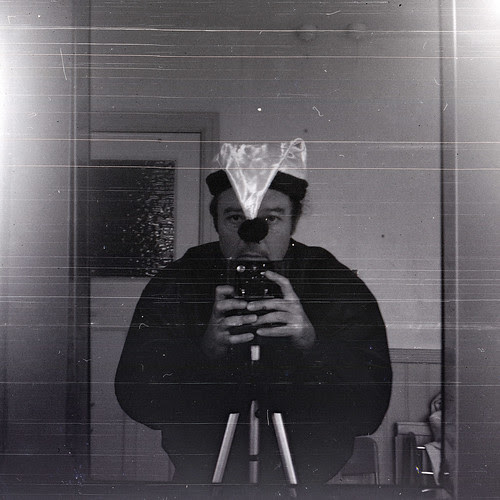 reflected self-portrait with Watch Carbine camera and droopy Xmas hat from Poundland by pho-Tony