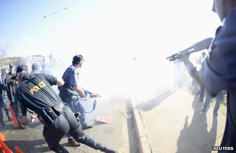 Riot police clash with protesters in Soweto, 29 June