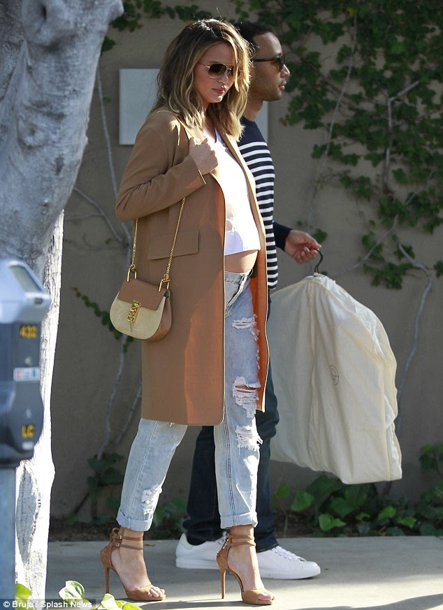 Retail therapy! The soon-to-be-parents spent the day shopping at Barneys New York