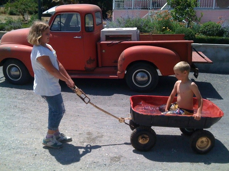 Skylar and Trey and their mobile swimming pool.