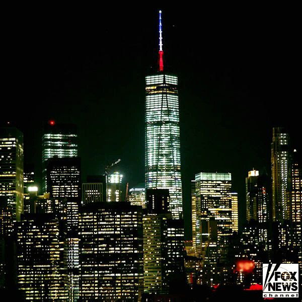 The antenna spire on the 1 World Trade Center is lit up in the colors of the French flag...to show solidarity for the people of Paris following the terrorist attacks on November 13, 2015.