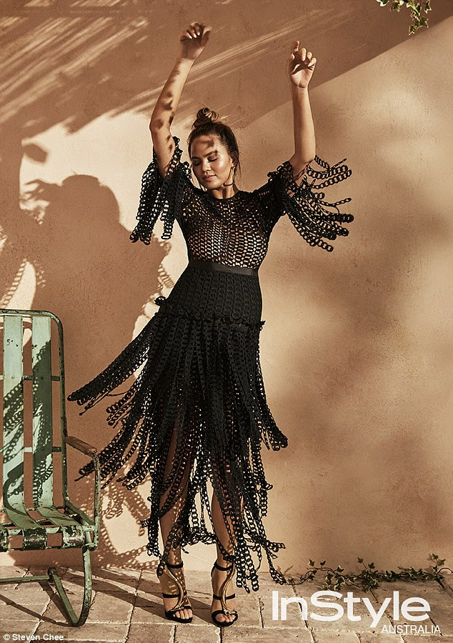 Flamenco: Another photograph has her twisting in a black cotton chain-linked dress by Romance Was Born