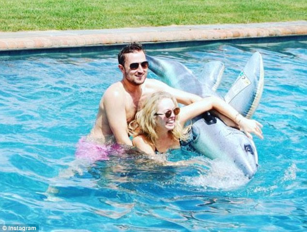 Look of love: Tiffany and her beau Ross had a blast splashing around in a pool together earlier this month
