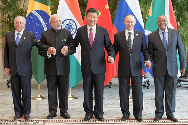 The BRICS summit will bring together 11 world leaders - here, Brazil's President Michel Temer,  Narendra Modi, China's President Xi Jinping, Russia's President Vladimir Putin, and South Africa's President Jacob Zuma (L-R) are pictured hand-in-hand at last year's event