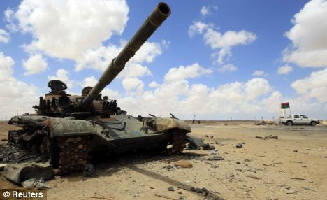 Target: A destroyed tank at the western entrance gate of Ajdabiyah. Drone missions will be able to more accurately pinpoint coalition air attacks