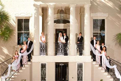 Pink Wedding. Bridal party outside reception venue, the