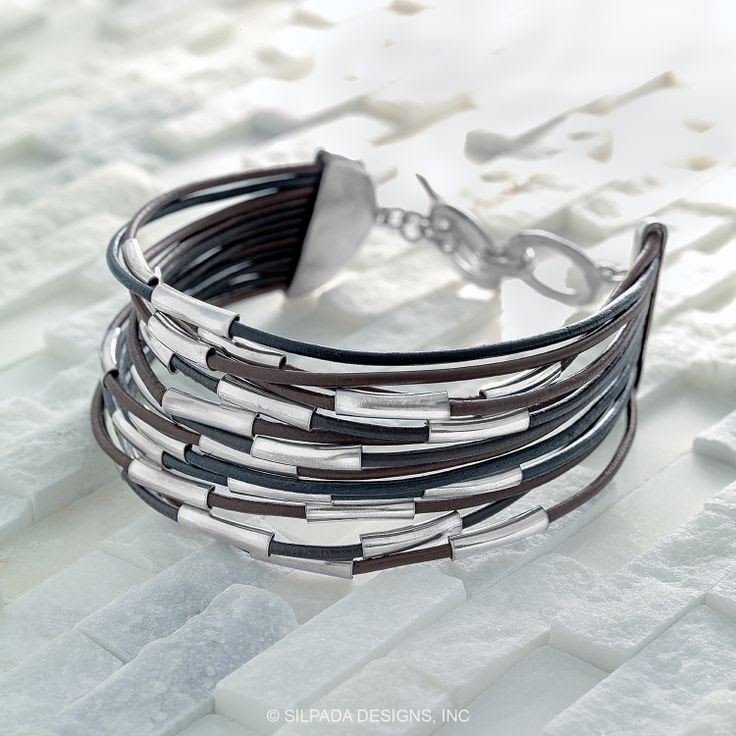 SPEED OF LIGHT BRACELET Scattered flashes of Sterling Silver create a cool kinetic effect on a multi-strand Leather Bracelet. Toggle Clasp.