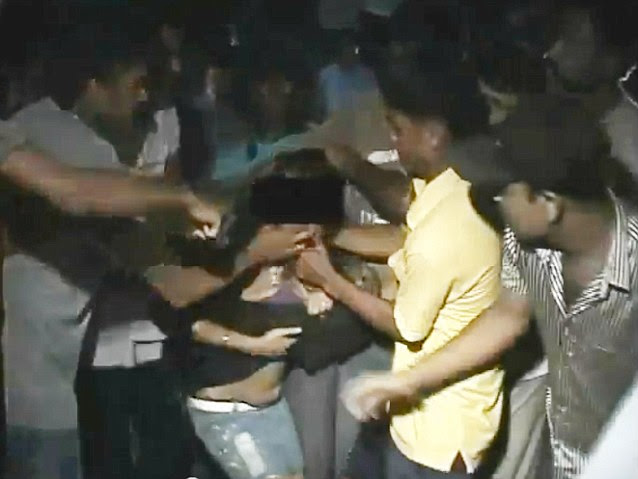 Shocking: A video captured the horrific moment a woman in India was set upon by a mob of at least 30 men in a city in India