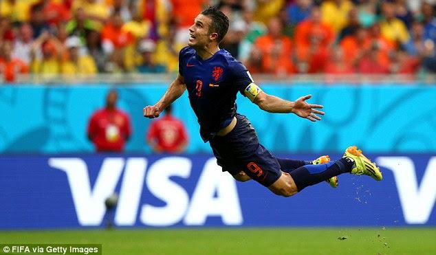 Aerial ultra: Van Persie hangs as he watches his header go into the Spain net