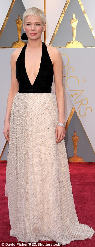 Stunning: Michelle Williams (left) and Emma Roberts donned very similar dresses as they hit the red carpet of the 89th Annual Academy Awards on Sunday
