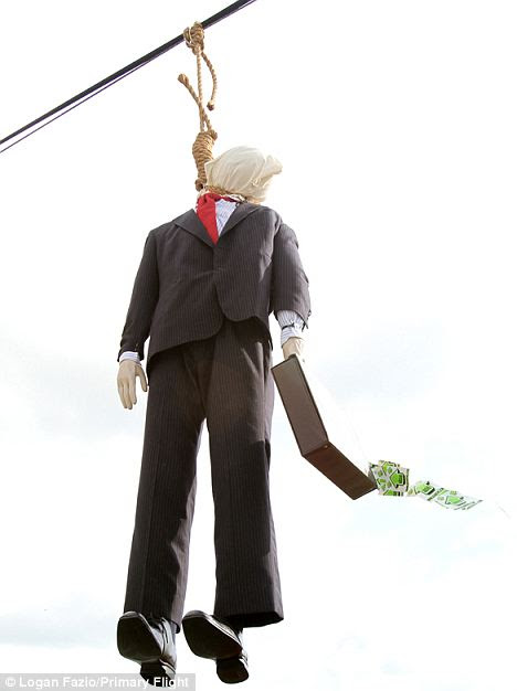 Scary sideshow: A graffiti artist attached a mannequin to a noose hanging alongside a major Florida highway as a part of the Occupy movement