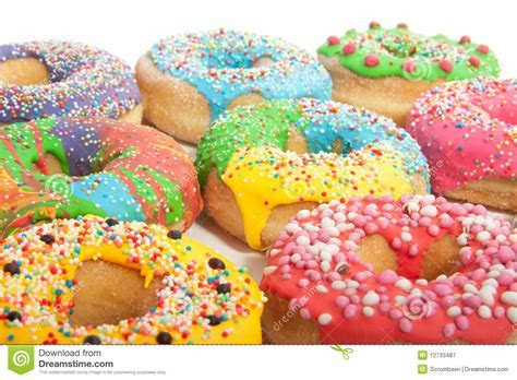 A Group Of Colorful Glazed Donuts Royalty Free Stock