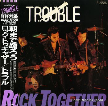 TROUBLE rock together