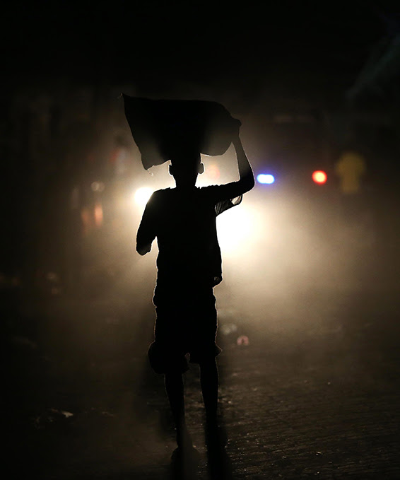 A man walks for a street without light due to a power failure in the wake of Hurricane Matthew in Jeremie, Haiti, 11 October 2016. The category 4 hurricane made landfall in the country on 04 October, leaving more than 900 people dead and thousands displaced. According to the United Nations, in the wake of the hurricane a cholera outbreak has spread throughout the population.  EPA/ORLANDO BARRIA