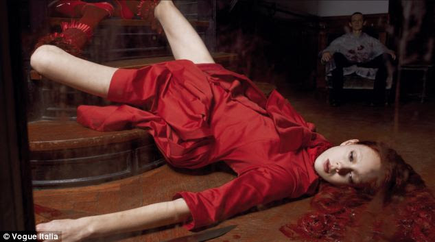 Outrage: This image of a woman bleeding and strewn across the floor in Vogue Italia has enraged readers