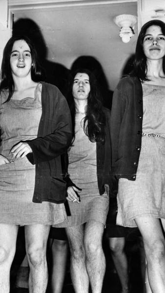 """Manson followers Susan Atkins, Patricia Krenwinkel and Leslie Van Houten walk into a morning court session in 1970. When Manson carved an """"X"""" into his forehead during the trial, his """"family"""" members followed suit."""