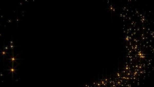 Swirling animation of sparkling gold stars on black ...