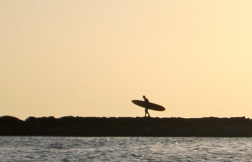 Surfer at my beach. Sunset, Waikiki.
