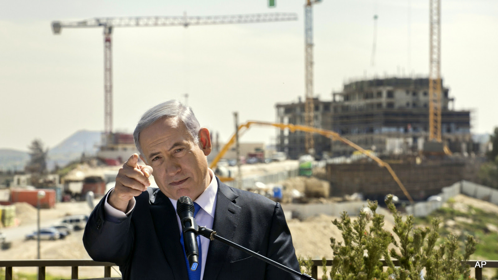 Israeli Prime Minister Benjamin Netanyahu speaks as he visits a settlement construction site in Har Homa