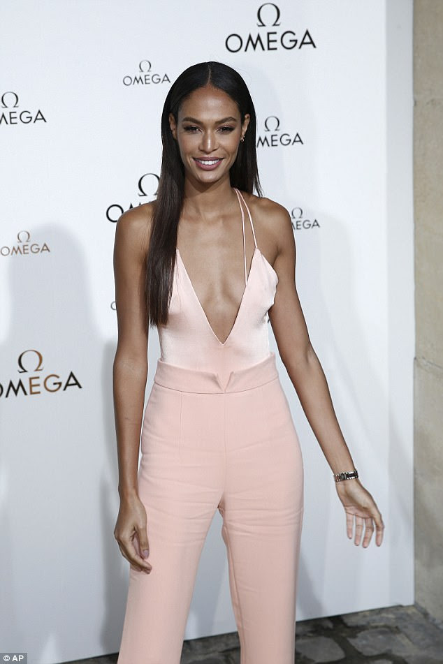 Fashion icon: Joan Smalls looked her sensational statuesque self when she headed to the Omega party for the Paris instalment of the sartorial festival on Friday
