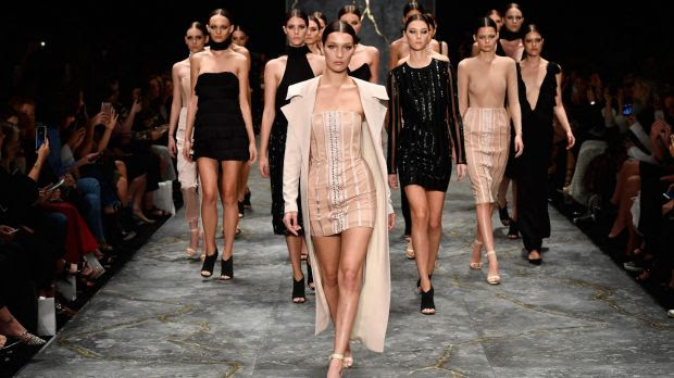 Bella Hadid leads the models as they walk the runway during the Misha show at Mercedes-Benz Fashion Week Resort 17 ...
