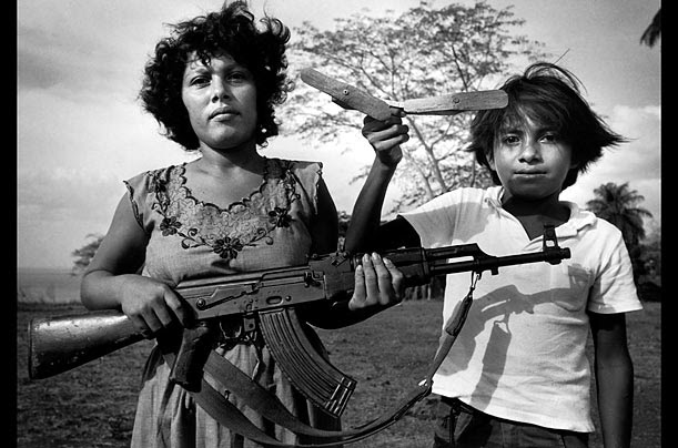Solentiname Islands, Nicaragua, 1984 A woman and child in socialist Nicaragua train with a local defense militia to fight against the invading contras, the U.S.-backed counterrevolutionaries that sought to remove the left-wing government.