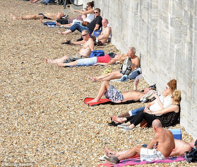 Life's a beach: In Portsmouth the sun-worshippers were out on force today