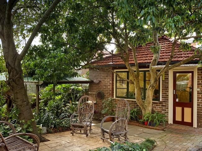 A rear extension, with a separate entrance, has two more bedrooms, a sitting room and bathroom. The house has been owned by a meditation organisation since 1986.