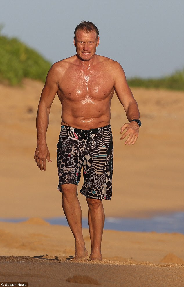 Action man! 58-year-old Dolph Lundgren proved that he's still got the body of a leading man, as he showed off his muscular arms and rippling abs whilst enjoying some winter sun in Hawaii