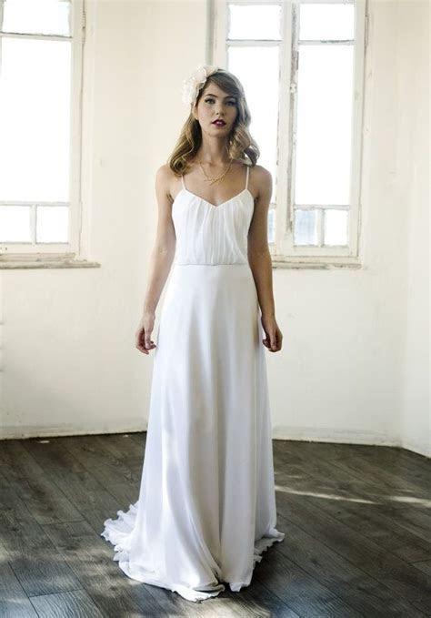 White chiffon blouson dress with pleats on top and chapel
