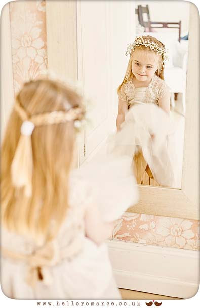 Flower girl bridesmaid looking in mirror - www.helloromance.co.uk