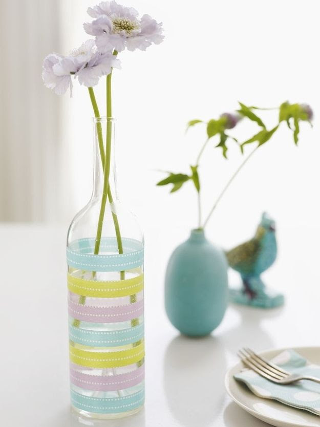 Decorate a bottle with washi tape to make a pretty, easy vase