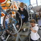 Students Blake Jamar (from left), Ryan Clifton and Gregory Gonzales take apart a bicycle that generates electricity at Analy High School in Sebastopol, Calif.