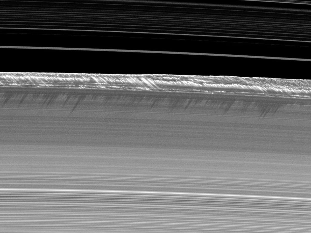 Though gossamer-thin, Cassini showed that Saturn's rings have complex structure. These roughly mile-high peaks cast shadows on nearby ring material.