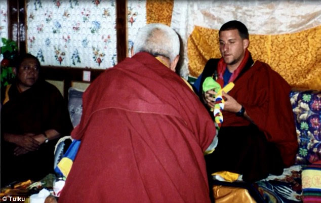Ashoka Mukpo, the NBC News cameraman infected with Ebola, was named the reincarnation of a Buddhist Lama. He is seen here in Tibet at a ceremony where he was enthroned as the ninth incarnation ofKhamnyon Rinpoche, the so-called 'Mad Yogi of Kham'