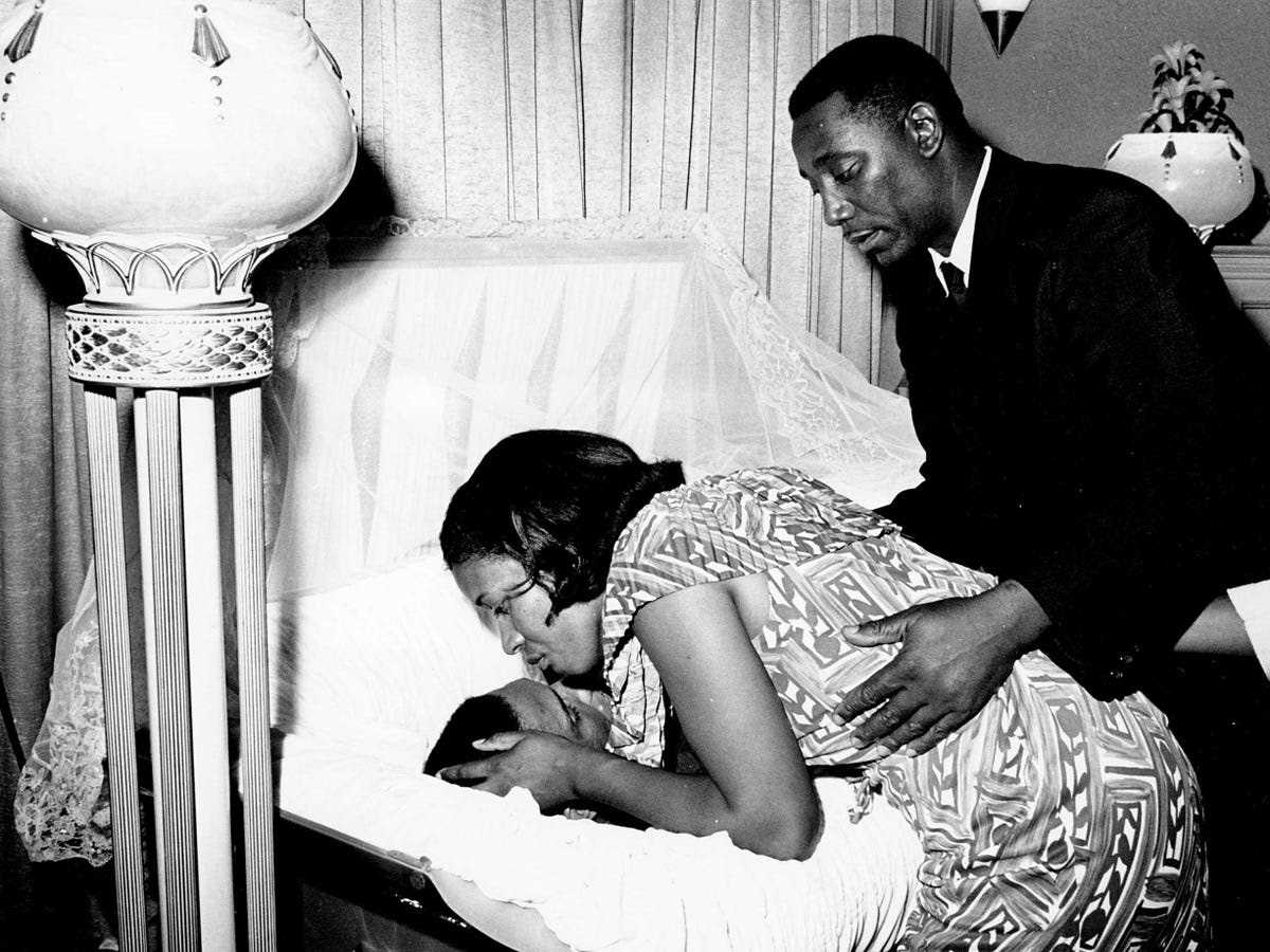 The assassination of Medgar Evers, the first director of the Mississippi NAACP, on June 12, 1963 also created outrage and sorrow in the black community. Below, his widow, Myrlie Louise Evers, bends down to kiss her deceased husband at a public viewing at a funeral home in Mississippi.