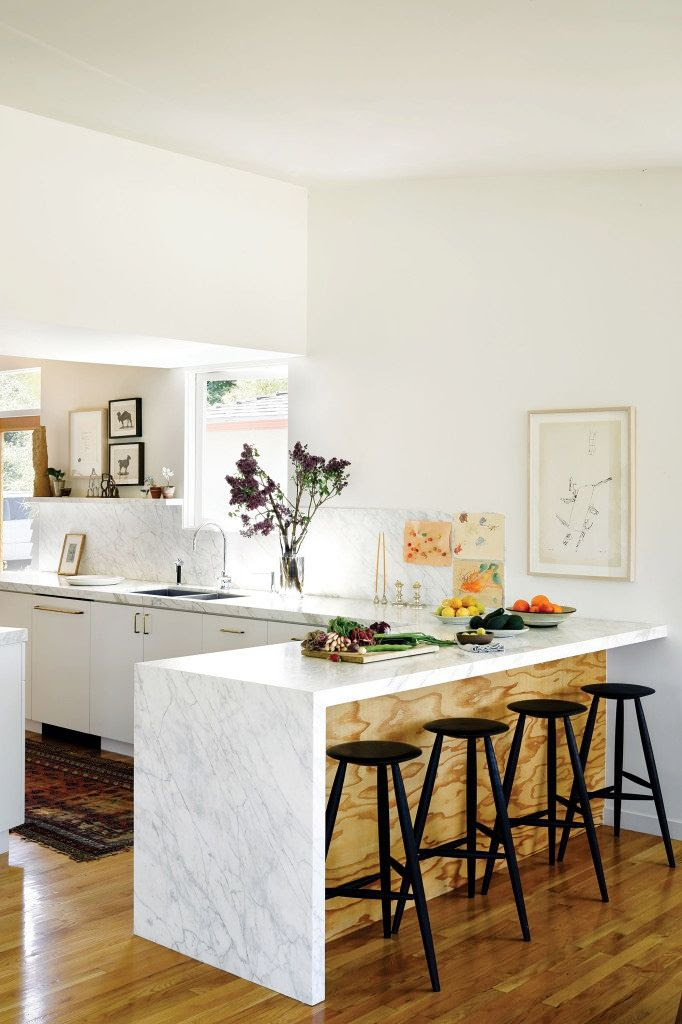 Le Fashion Blog -- Fashionable Home: Jessica De Ruiter's Mid-Century Modern Silver Lake Oasis -- Marble Kitchen with exposed wood and black stools -- Via C Home photo 2-Le-Fashion-Blog-Fashionable-Home-Jessica-De-Ruiter-Mid-Century-Modern-Silver-Lake-Marble-KitchenVia-C-Home.jpg