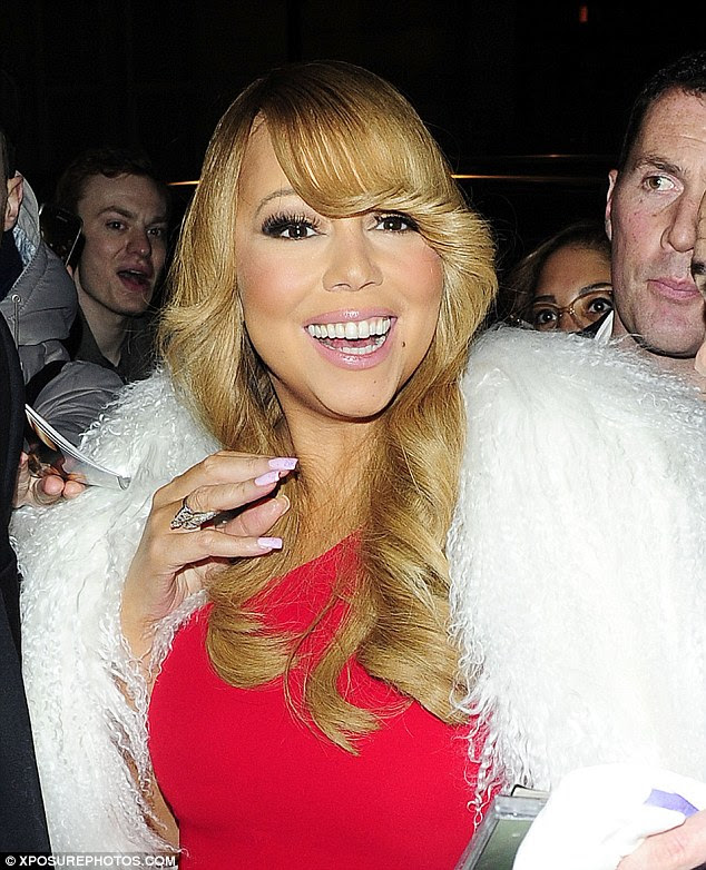 Dressed to the nines! Mariah oozed glamour as she made her way through the hustle and bustle