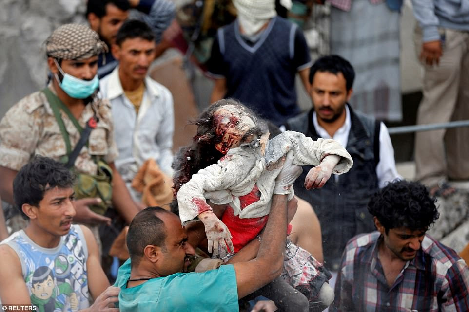 A medic holds the up body of seven-year-old Ayah Muhammad Mansour, who was recovered from under the rubble of a house destroyed by a Saudi-led air strike in Sanaa, Yemen, on August 25. Her sister Buthaina Muhammad Mansour survived the air strike in which eight members of the family were killed, according to relatives