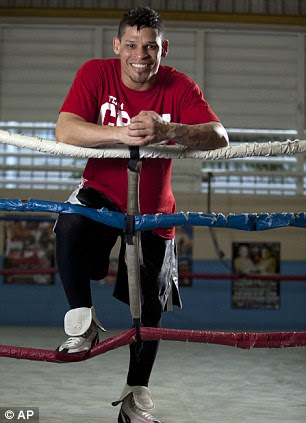 Boxer Orlando Cruz poses for pictures after a training session at a public gym in San Juan, Puerto Rico on Thursday after coming out as the first openly gay man in boxing